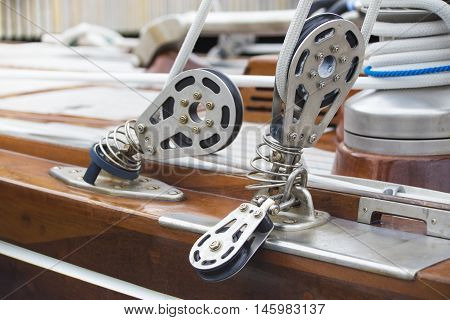 Close view of ropes fastening mechanisms in a yacht