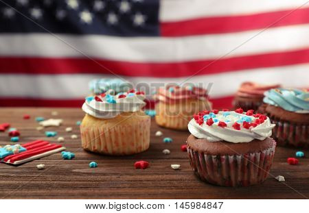 Delicious cupcakes on wooden table