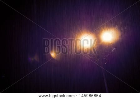 Light in the darkness of a rainy day in film tone