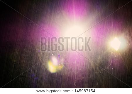 Light in the darkness of a rainy day at night