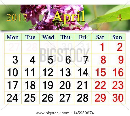 calendar for April 2017 with flowers of lilac. Calendar for printing and using in office life.