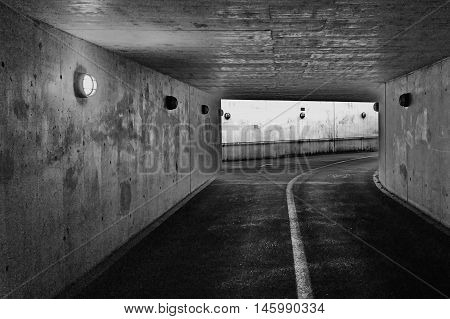 Dark passage underground in cement, concrete for pedestrian walkers and cyclists, taken in Baden, Switzerland