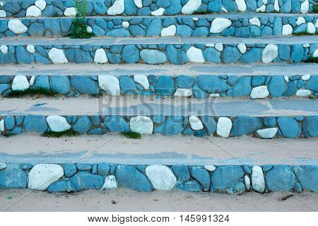 stone steps closeup with a spotty striped pattern of bright blue color for the abstract background or for wallpaper