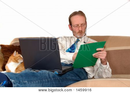 Businessman Working On Laptop At Home