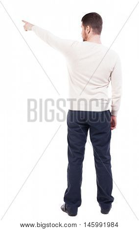 Back view of pointing business man. gesticulating young guy in black suit. Rear view people collection.  backside view of person.  Isolated over white background. office worker in a shirt and trousers