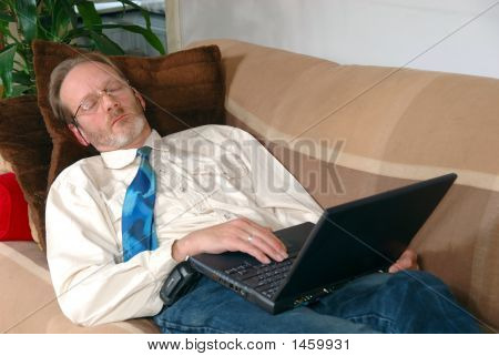 Businessman With  Laptop Sleeping
