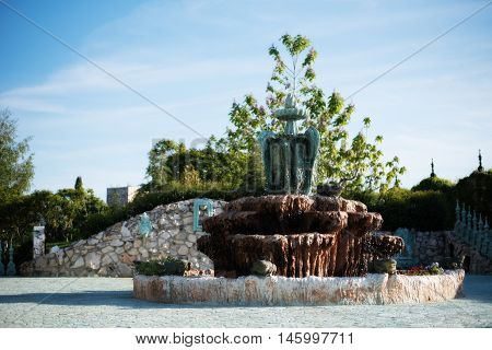 Antique Fountain In The Garden Of The Old Castle. Stone Walkway. Alley In Beautiful Garden With Flow