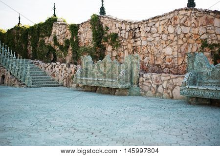 Stone Walkway. Alley In Beautiful Garden With Stone Benches, Flight Of Stairs,  Flowers And Trees Ar