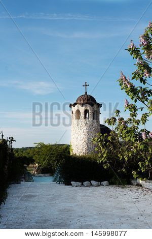 Old Stone Chapel In The Garden Of Fabulous Ancient Castle. Alley In Beautiful Garden With Flowers An