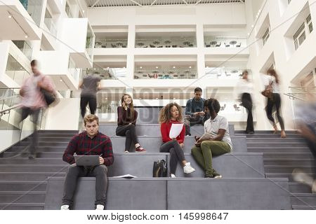 Interior Of Busy University Campus Building With Students