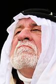 stock photo of arab man  - close up picture of old man in middle east wardrobe - JPG