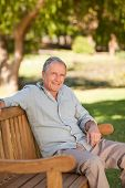 picture of portrait middle-aged man  - Senior man sitting on a bench - JPG