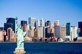 foto of new york skyline  - Statue of Liberty overlooking lower Manhattan and New York harbor - JPG