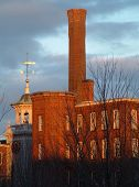 Sunlight On A Historic Mill Building In Lowell, Massachusetts