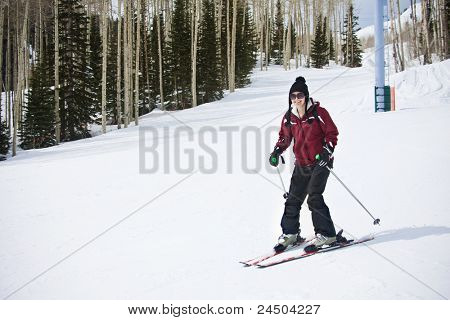 An Adult woman learning to Ski