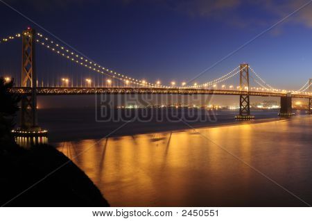 Bay Bridge, San Francisco Glows In The Dusk