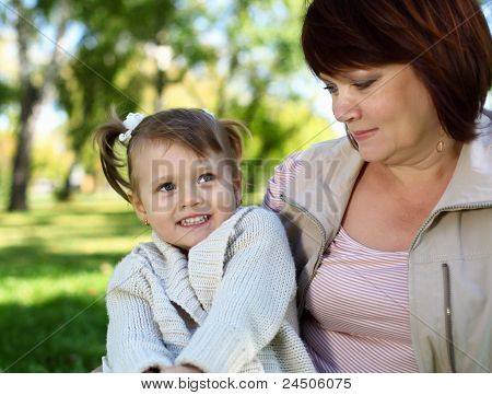 Grandmother with her little granddaghter in park