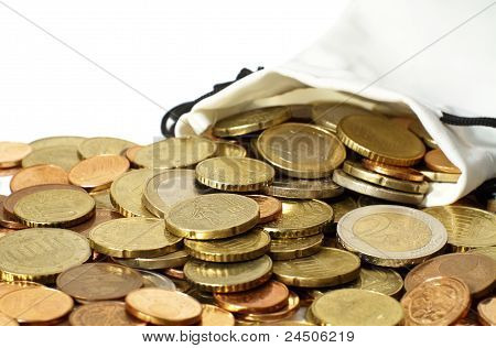 Money Pouch Of Euro Coins Spilled Out On A Table