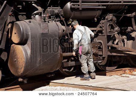 Mechanic Checks Locomotive