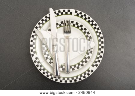 Fork Plate And Knife On A Table
