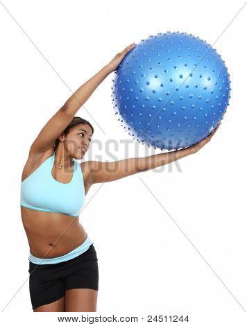 A pretty african american woman exercising over white background