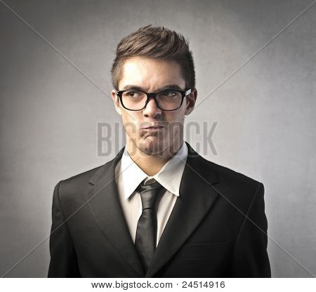 Businessman with doubtful expression