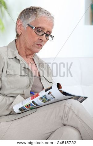 older lady reading magazine