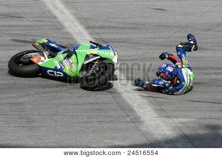 SEPANG, MALAYSIA - OCTOBER 21: Moto2 rider Kenan Sofuoglu falls at turn 15 during free practice at the Shell Advance Malaysian GP 2011 on October 21, 2011 at Sepang, Malaysia.