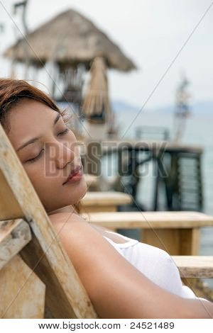 Girl resting on deck chair