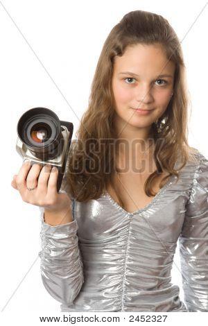 Chica joven con cámara réflex