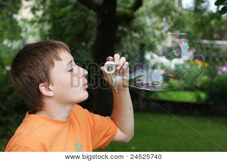 boy with big soap bubble