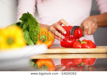 Peppers - Woman Cutting Red Pepper