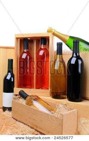An assortment of wine bottles on wooden crates. Vertical format.