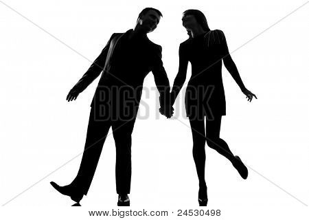 one lovers caucasian couple man and woman walking holding hands  in studio silhouette isolated on white background