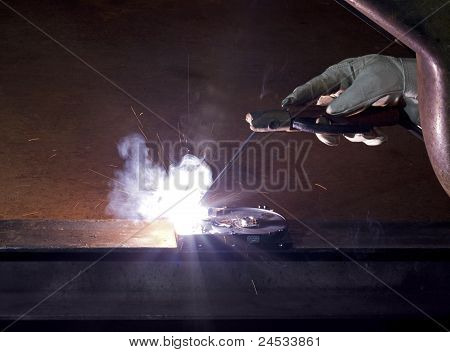 Welding On Open Hard Disk Drive In Rusty Background