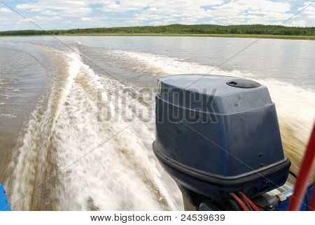 Outboard Motor Boat On The River