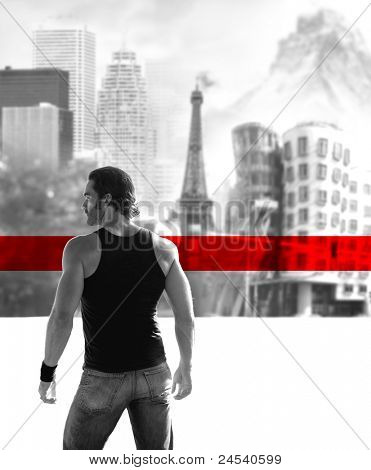 Fine art black and white concept photo of a young man in front of a blurred cityscape background with bold red horizontal stripe