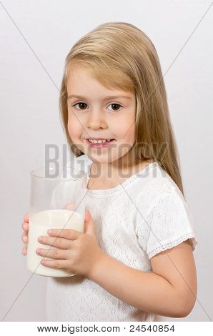 A girl with a big glass of milk