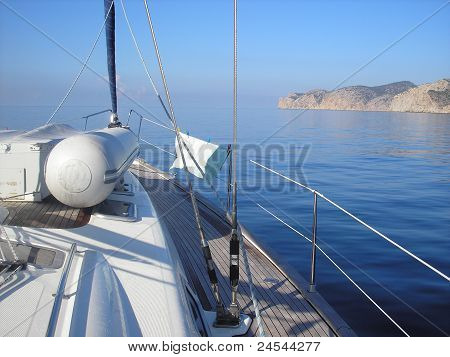 Sailing boat on glassy sea