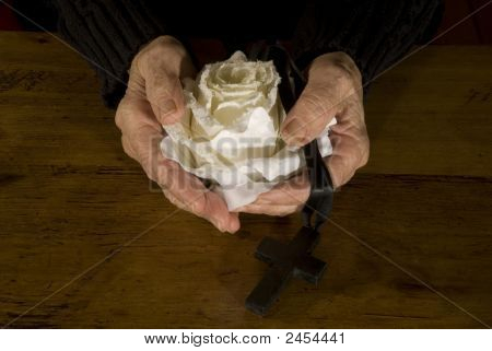 Old Hands With White Rose And Cross