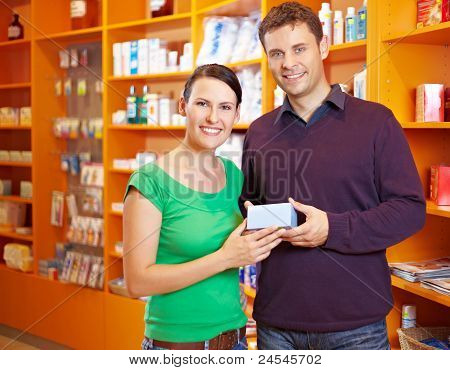 Couple Buying Medicine In Pharmacy
