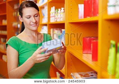 Woman Shopping In Drugstore