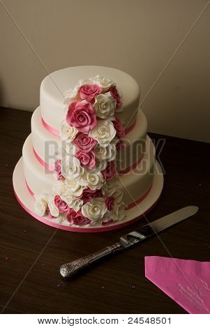 Three tier rose wedding cake