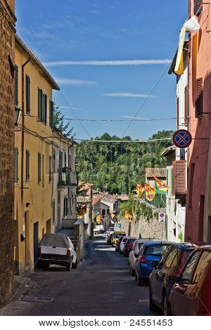Narrow Street Of Asciano, Italy