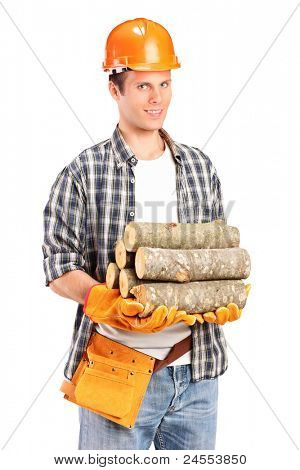 A studio shot of a young lumberjack holding a firewoods isolated on white background