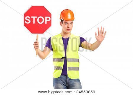 A construction worker holding a traffic sign stop isolated on white background