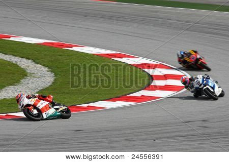 SEPANG, MALAYSIA - OCTOBER 22: Moto2 rider Stefan Bradl (65) leads the other riders at qualifying race of the Shell Advance Malaysian Motorcycle GP 2011 on October 22, 2011 at Sepang, Malaysia.