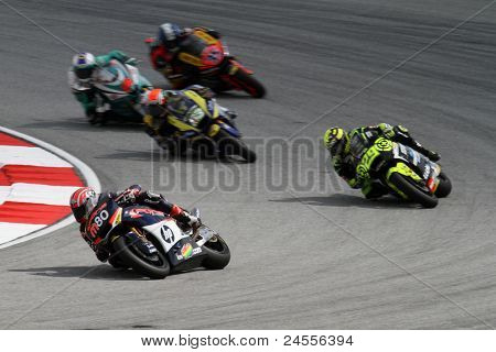 SEPANG, MALAYSIA - OCTOBER 22: Moto2 rider Axel Pons (80) competes with other riders at qualifying race of the Shell Advance Malaysian Motorcycle GP 2011 on October 22, 2011 at Sepang, Malaysia.
