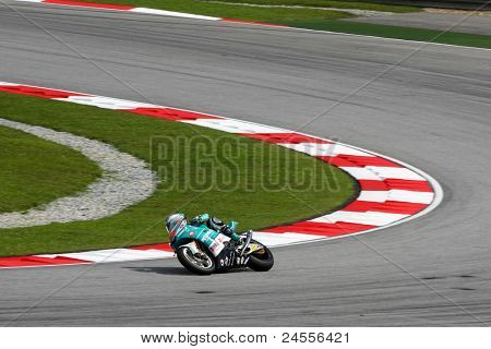 SEPANG, MALAYSIA - OCTOBER 22: Moto2 rider Hafizh Syahrin completes turn 1 at the qualifying race of the Shell Advance Malaysian Motorcycle GP 2011 on October 22, 2011 at Sepang, Malaysia.