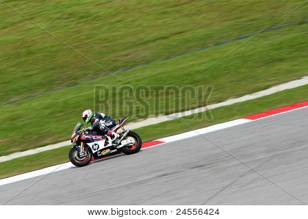 SEPANG, MALAYSIA - OCTOBER 22: Moto2 rider Alex Espargaro sprints after turn 2 during the qualifying session of the Shell Advance Malaysian Motorcycle GP 2011 on October 22, 2011 at Sepang, Malaysia.